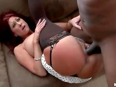 Redhead cougar with hot stockings enjoys interracial fucking
