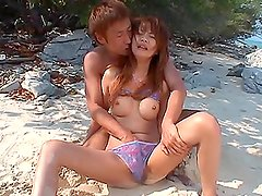 Rino Konno gets fucked on the beach after having oral sex