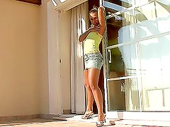 Lewd brown-haired slut finger-fucking her vagina on the balcony