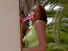 Beautiful brown-haired girl masturbating her pussy outdoors