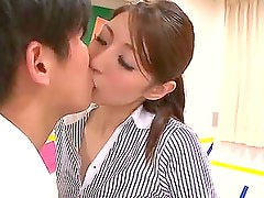 Hina Akiyoshi leans against a desk to get her pussy fucked