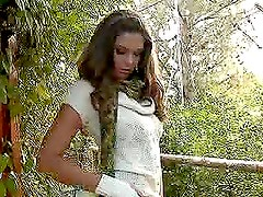 Adrienne Manning the hot brown-haired babe masturbates outdoors