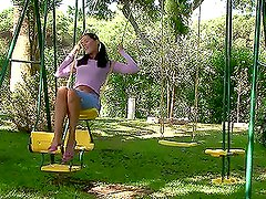Salacious brunette masturbating her pussy on a swing