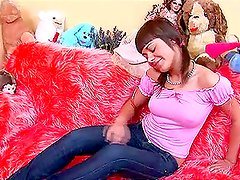 Sexy  brunette Alena is masturbating on a furry couch