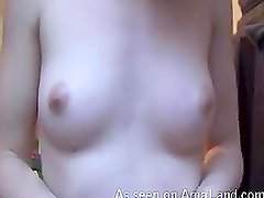 Nasty chick squeezing her tits in front of the webcam