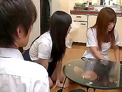 Two sexy Japanese schoolgirls give a blowjob and get fucked