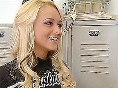 Briana Blair sucks and rides Peter North's cock in the locker room