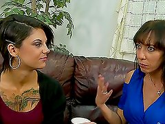 MILF babe teaches her tattooed daughter how to suck cock