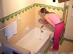 Horny masturbating chick gets caught on spycam in a bathroom