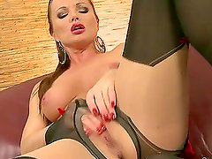 Adorable Silvia Saint fingers her hot pussy on the sofa