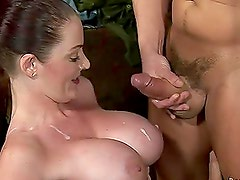 Two busty girls suck a cock and get cum on their boobs
