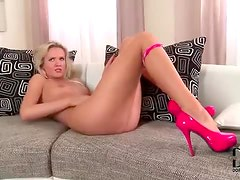 Leggy blonde in sexy panties rubbing her pussy
