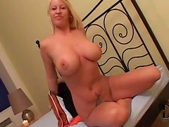 Beautiful blonde milf lets her giant tits out