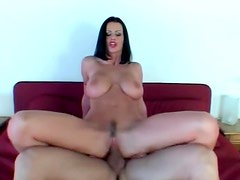 Luscious raven haired goddess impaled on huge cock