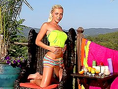 A hot sexy blonde bitch masturbates plays with anal beads