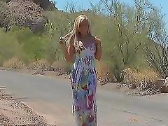 Salacious blonde Kelly fingers her pussy during a walk