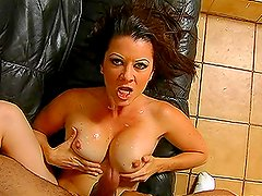 Bosomy chick Raquel imagines herself to be a cowgirl