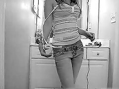 A cute teen strips and shows her nice body for the webcam
