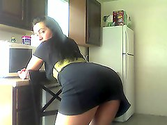 Kitchen stipping by busty babe Naomy Waters in a sexy dress