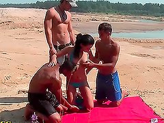 Sexy adorable girl knows exactly how to amuse three guys at once