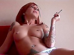 Redheaded Scarlett Pain is smoking a cigarette and drinking coffee naked
