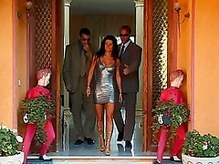 Two bodyguards fuck a horny brunette in the passage