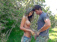 Young amateur couple kissing in the forest