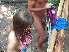 Three guys fuck a sexy brunette in a foursome group sex