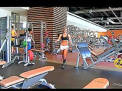 Well-shaped sexy babe with big bobs is exersising in the gym and maturbates