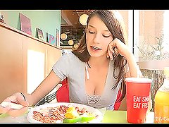 Pretty Brunette Babe Flashing Her Boobs While She Eats in Restaurant