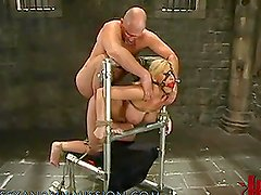 Busty Blonde Gets a Treat in the Dungeon