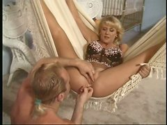 Foxy mom Jenny Lee McKenzie blowjobs in vintage-styled sex video
