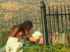 Dark chocolate Sheeba fucks whitie on a terrace outdoor