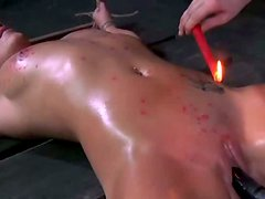 Sweaty crucified blond head gets wax on her boobs