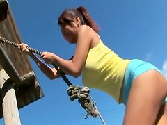 Alluring Japanese babe Kana Tsugihara has fun on a playing ground and then poses on a cam wearing seductive bikini