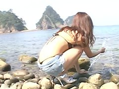 Sweet japanese babe Rimi Tachibana poses on a cam and sucks a lollipop