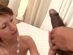Skinny milf Amanda Vamp blows black cock and rides it