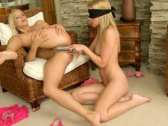 Brandy Smile and her blonde girlfriend pump each other with a dildo