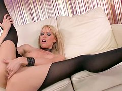 Curvy blonde whore Sophie Moone treats her cunt with fingering