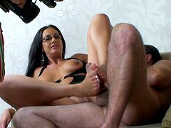 Rubbing a cock is a specialization of horny brunette Emma Butt