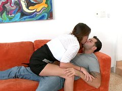Scorching brown haired MILF gives blowjob on the couch