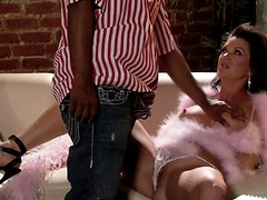 Busty cougar Raquel Devine gives awesome fellatio to young black man