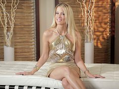 Gorgeous blonde whore Julia Ann masturbates with a vibrator