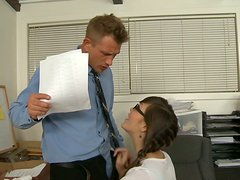 Hot brunette with pigtail Holly Michaels gives blowjob at office workplace