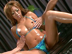 Steamy asian bitch Maeda Hina is oiled all over the body and gets her wet pussy fingered
