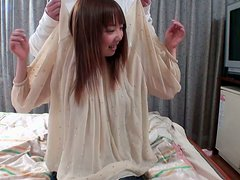 Obedient Japanese teen is undressed and fondled