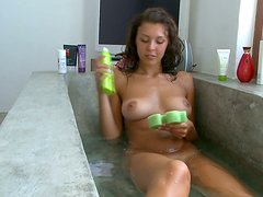 Curly busty teen with fantastic body takes bubble bath and msaturbates.
