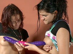 Duet of barely legal skinny lesbo teens kissing and sucking double sided dildo.