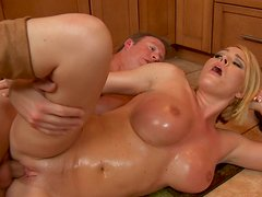 Oiled huge tits of Krissy Lynn and her pussy got pushed hard on a kitchen floor
