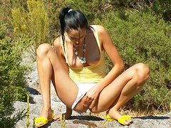 Skinny and ugly teen is stripping outdoors and rubbing her clit